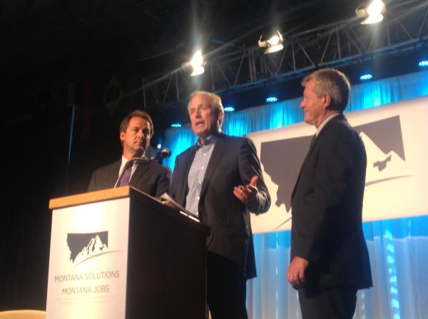 Boeing CEO Jim McNerney (center) announces an expansion to the company's Helena facility at the Montana Economic Development Summit along with Gov. Steve Bullock (left) and Sen. Max Baucus