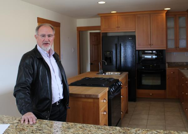 Real estate broker Alan Bock shows off a $375,000 home near Helena, which is about $175,000 more than the counties median price.