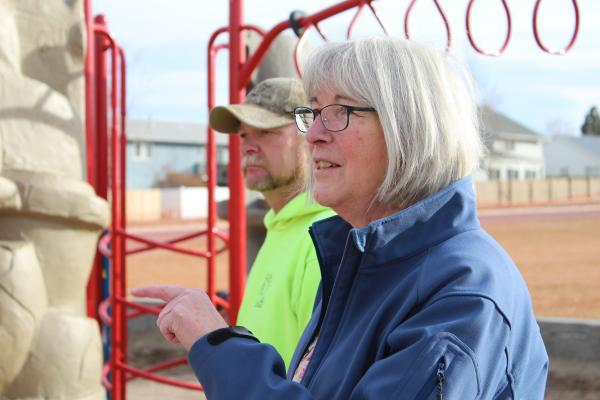 "Alicia Pichette watches the construction of some ""all-inclusive"" playground equipment in Helena's Jaycee Park. Pichette started a fund to install such equipment after the death of her disabled daughter, Blythe."