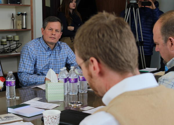 Jim Smith with the Montana Independent Bankers (right) speaks to Congressman Steve Daines about his concerns about the Affordable Care Act during a Monday roundtable in Helena.