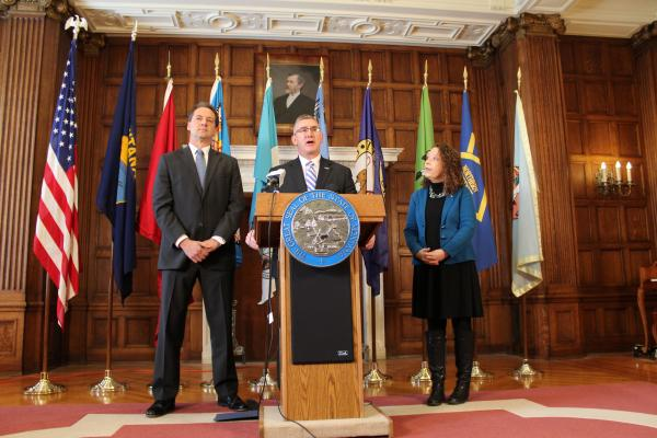 Gov. Steve Bullock, Lt. Gov. John Walsh and Walsh's wife, Janet on the day of Walsh's appointment to the U.S. Senate.