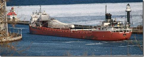 The John G. Munson departing Duluth on March 23, 2015 at 5:29 pm. She came in for winter layup on January 20, 2015 and spent the last two months at Fraser Shipyards in Superior. She came out of the shipyard and went to the Canadian National (CN) dock in W