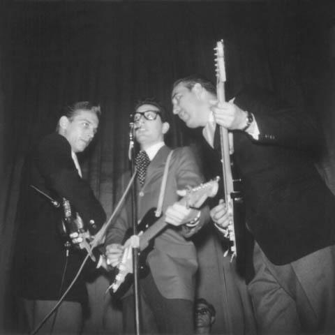 Waylon Jennings, Buddy Holly and Tommy Allsup perform during the Winter Dance Party concert at the Duluth Armory on Jan. 31, 1959.