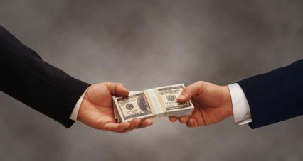 http://nc-democracy.org/wp-content/themes/DemNCv1/images/money-handshake.jpg