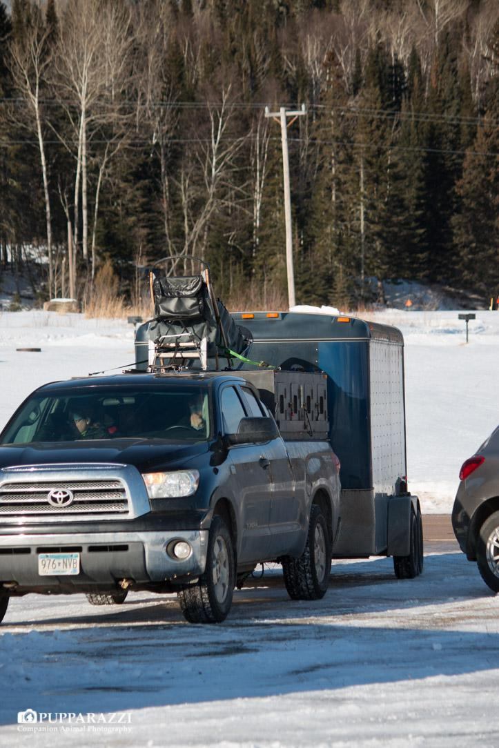 Dog trucks start arriving at the Grand Portage Marina to support arriving mushers
