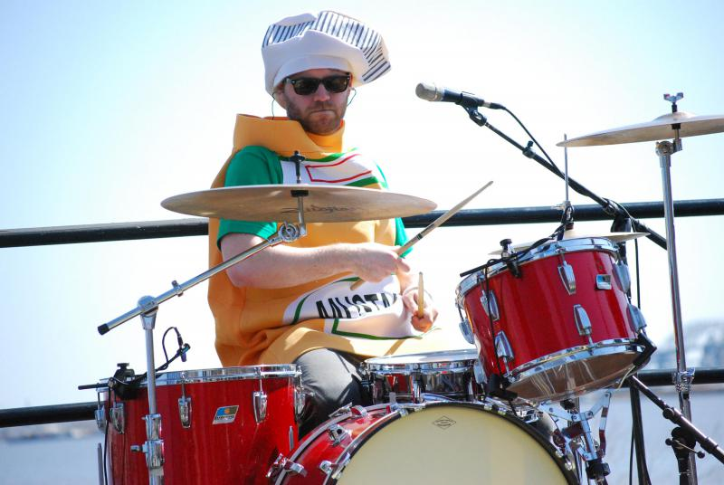 Drummer dressed in a mustard costume