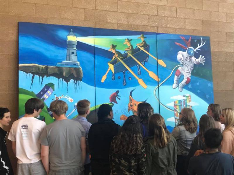 Chrissy Valento, Jonathan Thunder and Lincoln Park Middle School students revealed their mural Friday