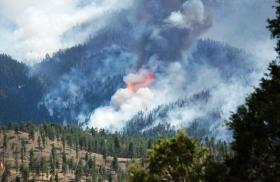 The Lime Gulch fire is one of 12 wildfires currently burning in the state. Photograph from June 21.