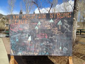 Near downtown Estes Park, a chalkboard collects reflections on how the September flood impacted town.