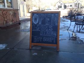 A sign right outside the St. Vrain Market in Lyons.