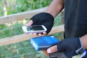 An M-Pod in use along with a smart phone on the South Boulder Creek trail. The M-Pod can sense a wide range of air quality metrics.