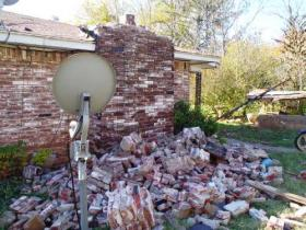 House damage in central Oklahoma from the magnitude 5.6 earthquake on Nov. 6, 2011. Research conducted by USGS geophysicist Elizabeth Cochran and her university-based colleagues suggests that this earthquake was induced by injection into deep disposal wells in the Wilzetta North field.