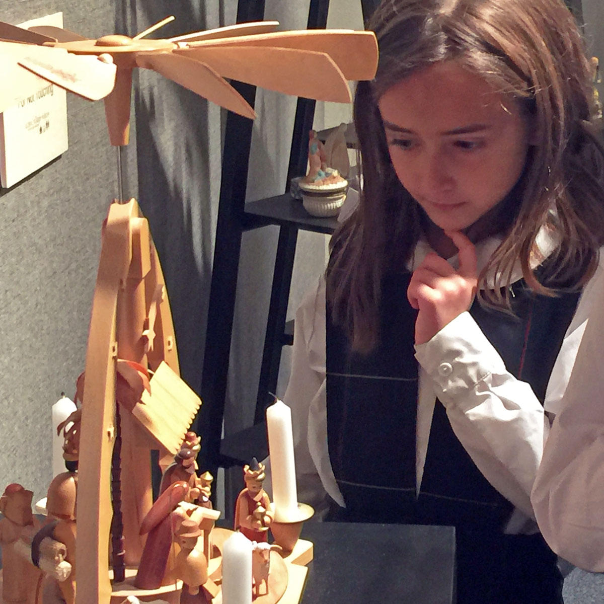 Saint Joseph Catholic School student views a nativity scene at the Nativities Around the World exhibit - Global Village Museum - Ft. Collins - CO