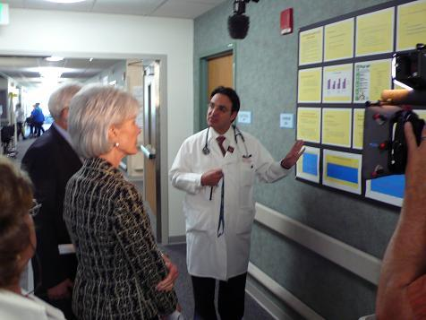 ICU Dr. Ivor Douglas gives Health and Human Services Secretary Kathleen Sebelius a tour at Denver Health Wednesday.