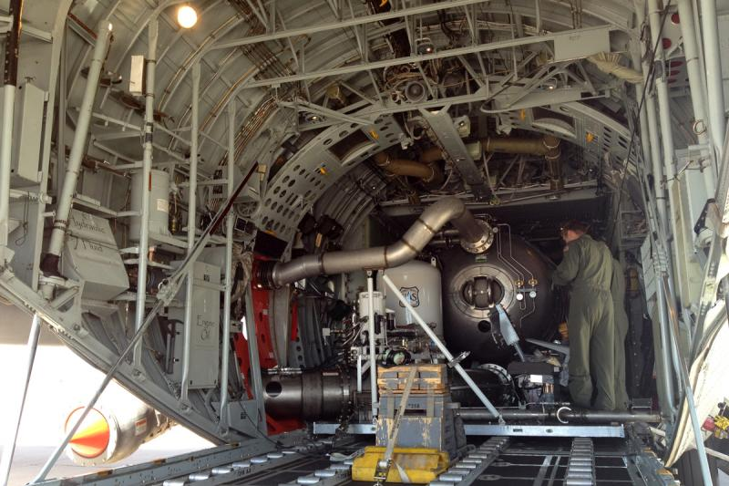 MAFFS installed in the payload bay of a C-130. The discharge nozzle is visible in the lower left hand corner.