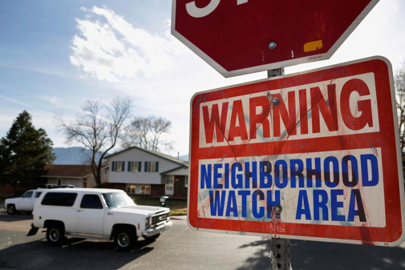 """A graffiti-ridden """"Neighborhood Watch"""" sign at the edge of Census Tract 54:00 in Colorado Springs on May 3, 2013."""