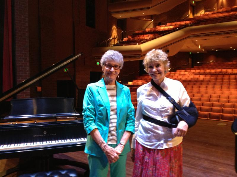 Sisters Phyliss Eaton, pianist, and actress Maggie Peterson Mancuso on stage at Greeley's UCCC. Mancuso sang at the UCCC's opening and Eaton will play during Sunday's 25th anniversary celebration.