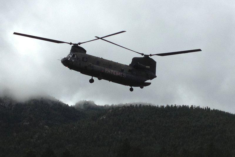 One of the National Guard's CH-47 Chinook helicopters descends to evacuate several residents from the Pinewood Springs area, Sept. 16.