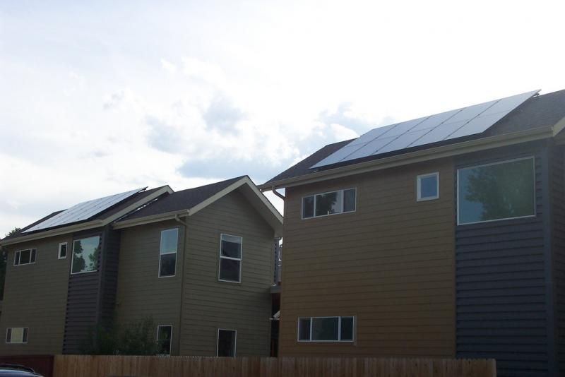 Rooftop solar panels on homes in Boulder, Colo.