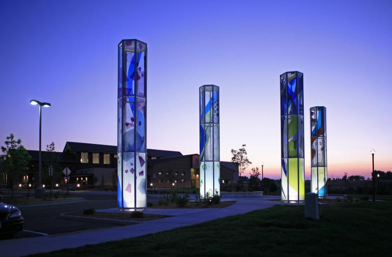 """""""Luminaries"""" sculpture is part of Greeley's public art collection. The four, 30-foot, glass towers represent the four seasons."""