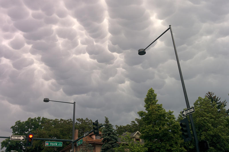Storm clouds roll in over 14th and York Street in Denver, Colo.