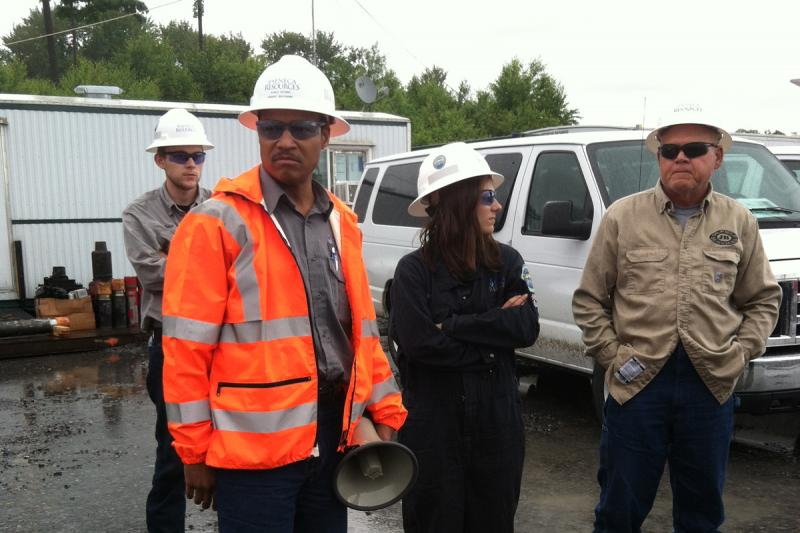 Rob Boulware, director of communications for Seneca Resources, shows journalists around a drilling site.