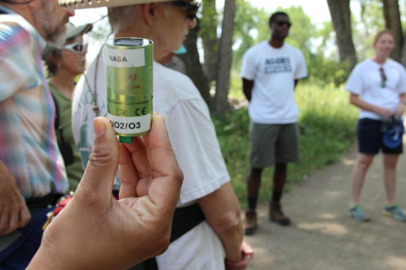 A CairClip, about the size of a 35mm film canister, is a portable ozone sensor that can be early carried -- including on this hike in Boulder.