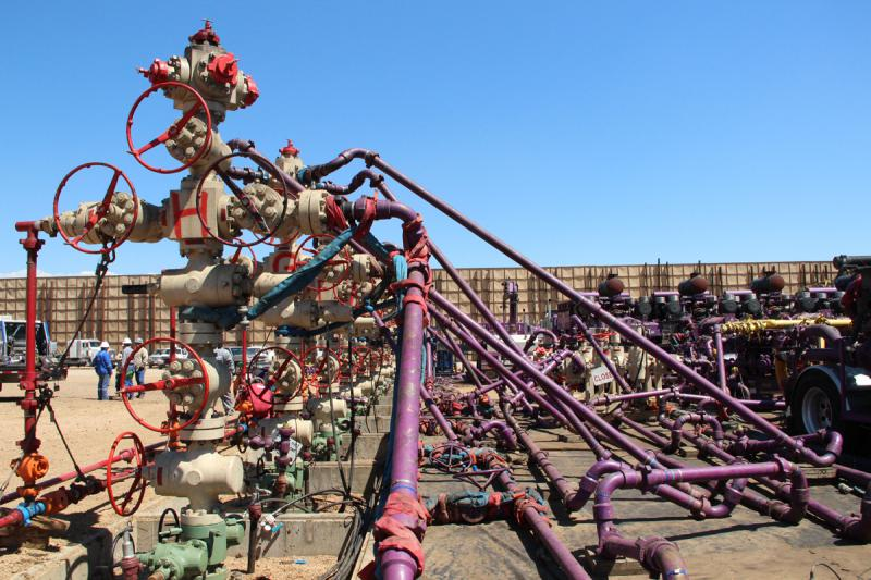 A maze of pipes used for hydraulically fracturing wells, on a well pad near the city of Longmont, Colo.
