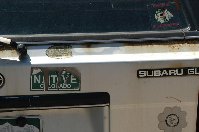 This worn native bumper sticker is surely a sign of a longtime Coloradan. Sames goes for the Moe's sticker. Only the Chicago Blackhawks sticker calls their status into question.