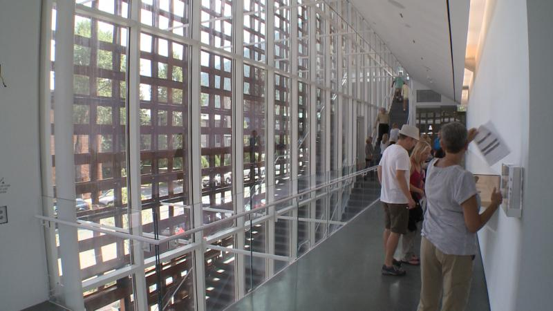 Windows run from floor to ceiling at the Aspen Art Museum, which allow for natural light to spill in.