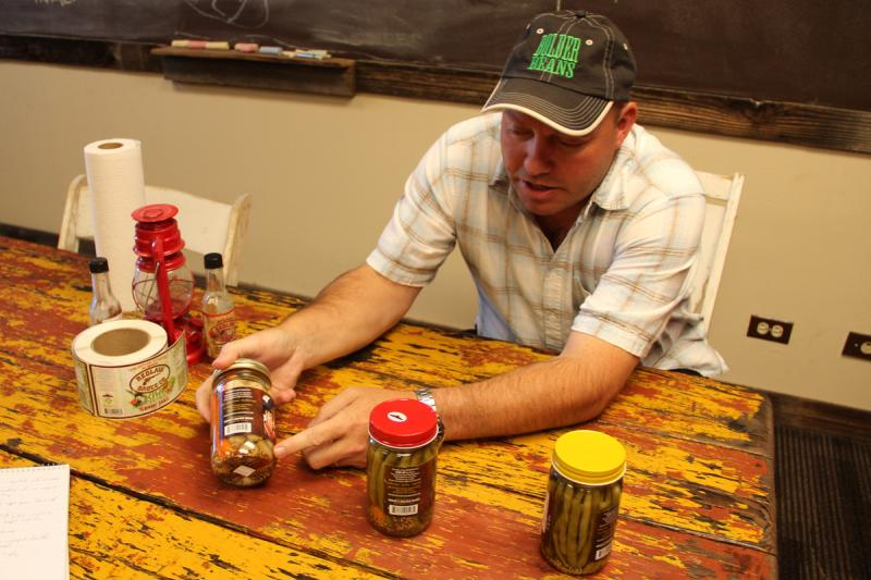 Rogue Edwards, of Bolder Beans, shows off his pickled products.