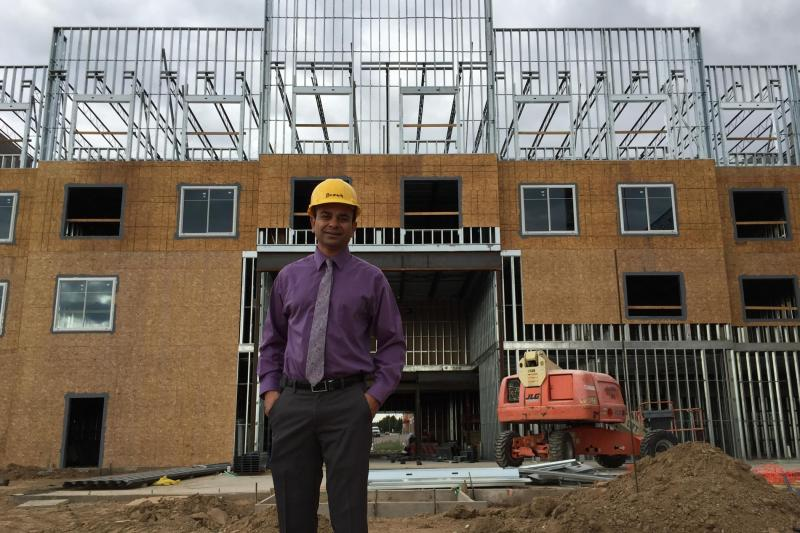 Hotel developer David Amin stands in front of the future Homewood Inn and Suites in Greeley, Colo.