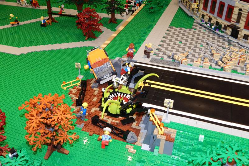 Playful elements can be used to help solve design challenges.  Here, the road parallel to the CU stadium was too long for the Lego version, which is why a blacktop swallowing alien was added.