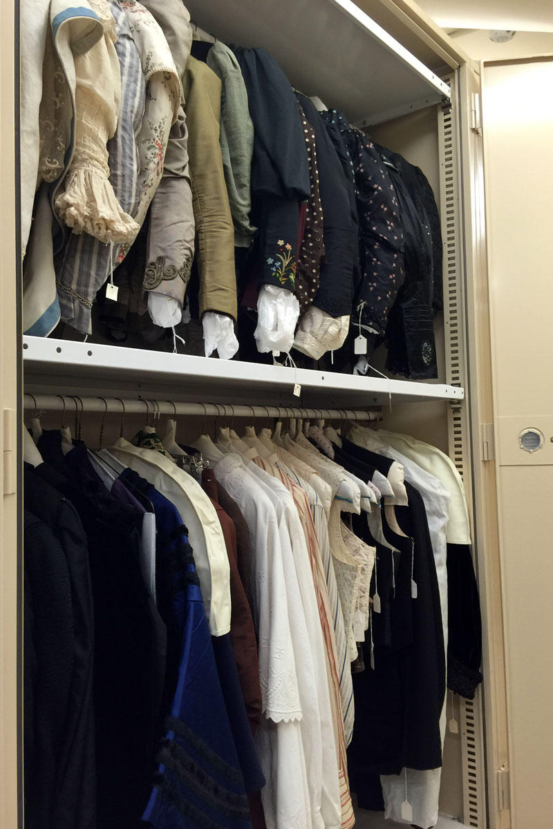 Bodices and skirts from the 1890s hang in one of dozens of storage cabinets at CSU's Avenir Museum.