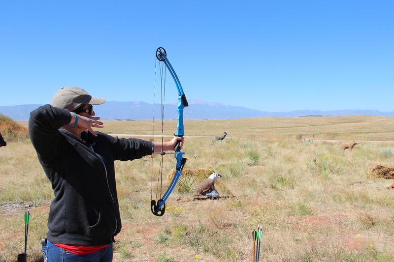 Heather Gaffney, of Woodland Park, lets an arrow fly at Colorado Parks and Wildlife Ladies Cast and Blast event at the Pikes Peak Gun Club.