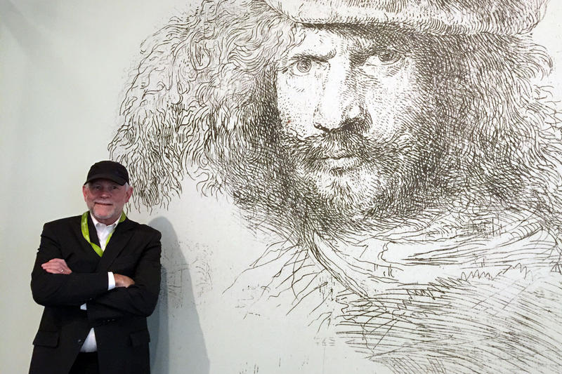Denver Art Museum curator Timothy Standring stands next to the opening image of the museum's new exhibit following the artist Giovanni Benedetto Castiglione.