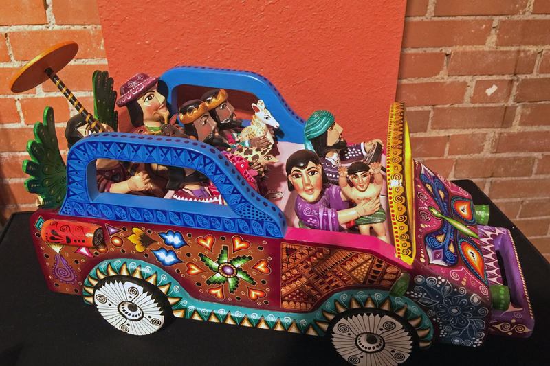 A nativity set from Mexico depicts the Holy Family in a colorful car