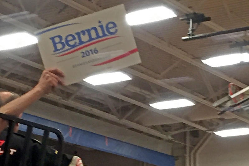 A Sanders supporter waves a 'Bernie 2016' sign during the Colorado Caucus, held Mar. 1, 2016.
