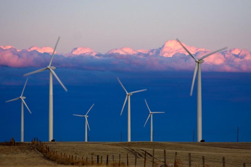 Turbines spin in a wind farm.