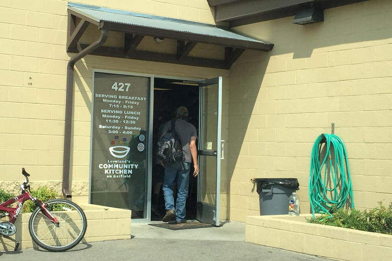 Clients enter Loveland's Community Kitchen for one of three daily meals.