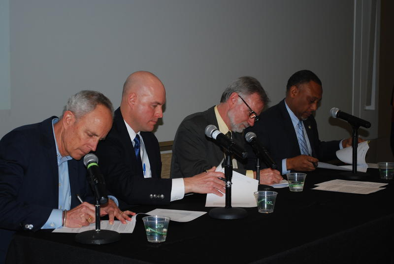 Left to right: Jim Lochhead, Clint Evans, Mike Lester and Brian Ferebee sign a memorandum of understanding in Denver, Colorado, on Feb. 27, to renew and expand the FROM FORESTS TO FAUCETS PARTNERSHIP. The partnership is intended to proactively conduct tre