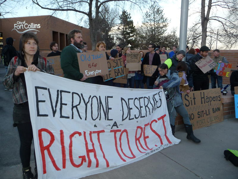 Protesters chanted and held signs outside Fort Collins City Hall prior to the March 7 city council meeting.