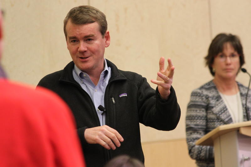 Senator Michael Bennet answers a question at a town hall meeting at Colorado State University.