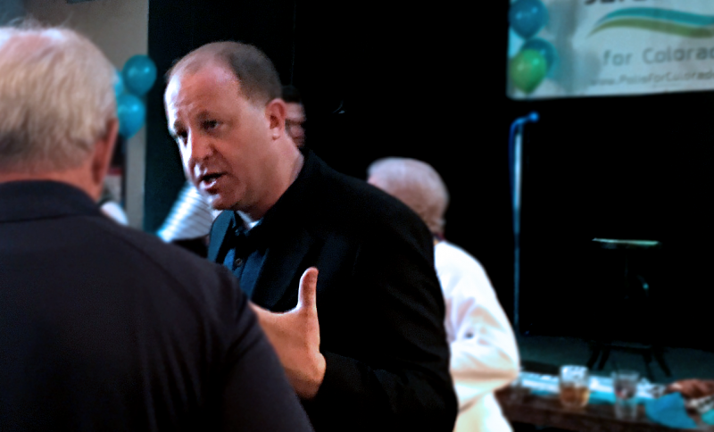 Jared Polis speaking at a campaign event.