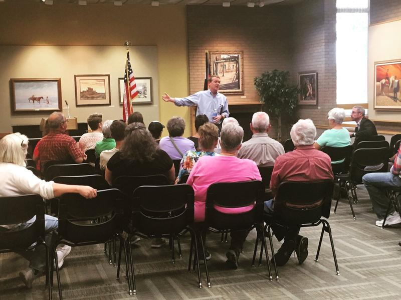 Sen. Michael Bennet speaks at a town hall held in Greeley on Aug. 8.