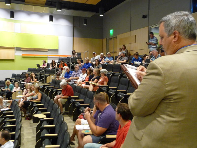Robert Mitchell, director of education preparation takes notes at the town hall meeting at Colorado State University July 28, 2017.
