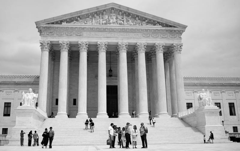 Visitors gather outside the steps of the U.S. Supreme Court in Washington, D.C.