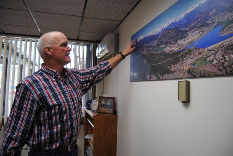 Mayor Todd Jirsa points out the mountains surrounding Estes Park. Jirsa says a substantial increase in the entrance fee for Rocky Mountain National Park would drive certain visitors away.