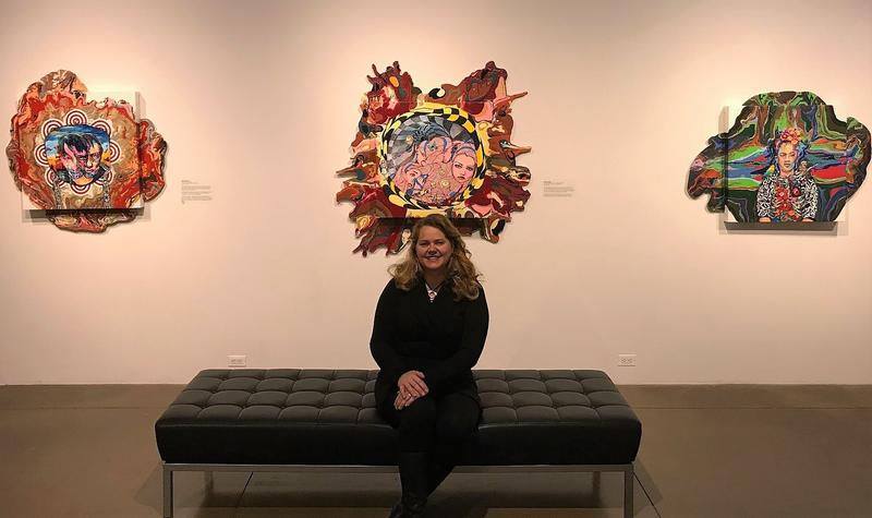 Fort Collins artist Jennifer Ivanovic sits in front of several of her Stigma Stains at the Fort Collins Lincoln Center.