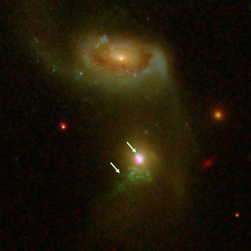 In This Image Of A Far Away Galaxy The Arrows Point To Two Bursts